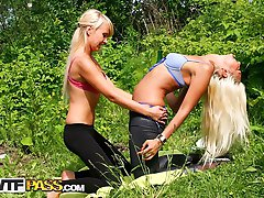 Two blondes play with rod on outdoor sex movie