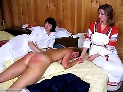 Group punishment of young ladies in a woodshed