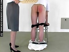 Bent over the chair in pain - bare assed guy gts his buttocks blistered by strict bitch