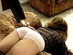 Caned over the couch on her big round naked ass