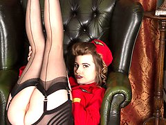 Brook is one sexy air hostess in her clingy red uniform with sheer black nylon blouse and red...