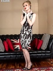 Seductress Michelle in slinky dress, blonde hair up, sheer nylons and full red lips!