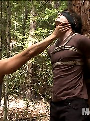 Van is walking through the woods when he finds bound hunk Dirk Wakefield tied to a tree with a blindfold around his eyes.  Dirk's stripped naked in the middle of the woods as Van begins teasing the boy's cock.  After a few edges, Dirk's legs are lifted off the ground as Dirk helplessly dangles from the tree, begging to cum.  The boy's arms and legs are tied up and spread apart as Dirk lays in the dirt with his hard cock between his legs.  A prostate massager is shoved up the stud's hairy hole while his cock is edged again and again until he finally shoots his load all over himself.