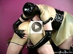 Bound latex slave receives CBT from latex Mistress