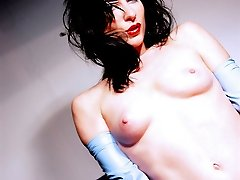goth nerd in latex librarian dress strips nude