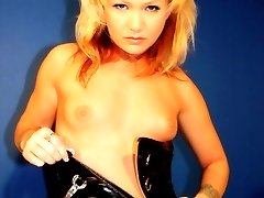 Innocent blonde in black latex