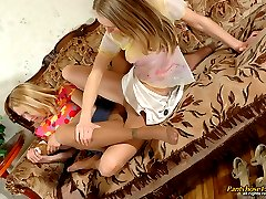 Vivacious chicks in barely visible pantyhose pleasing each other on sofa