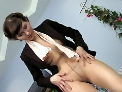 Sexy businesswoman flashes her nylon waistband before putting on new tights