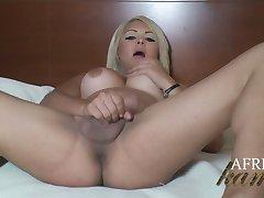 Caucasian Tranny Afrika Kampos in black lingerie stroking her pretty shecock