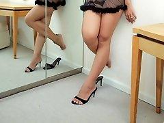 Ladyboy Eye by the mirror in her see-thru nightie