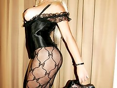 Huge tits blonde TS in a corset and bodystocking