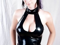TS in black leather with latex dildo in her ass