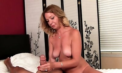 Hot blonde smoker looks very sexy in lingerie and with cigarette
