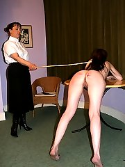 Severe caning for naked girl bent across the table in pain