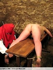 Brutal bare ass beatings in the dungeon - naked asses with stripes welts and bruises