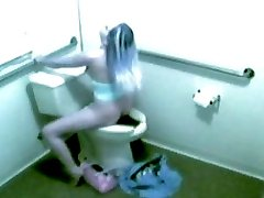 Oblivious to the camera this girl cums on a toliet