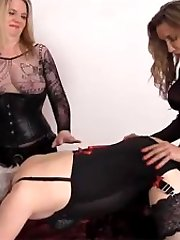 Strapon Jane and a blonde FemDom punish a horny TGirl with their strapon cocks.