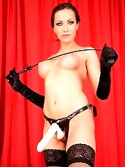 Horny Mistress Asya in black gloves and stockings with a pink strapon waits her boy to give him a cock in a mouth