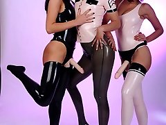 Lovely ladies in latex pose with strapons