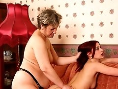 Mature dominating lady fucking her younger girlfriendbr