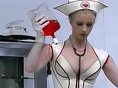 Dominant lady in nurse uniform training her pretty female slave in latex