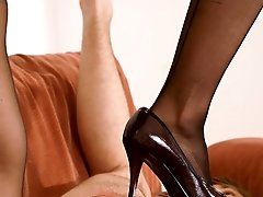 Juicy dark-haired femdom mistress saddles her submissive young boyfriend