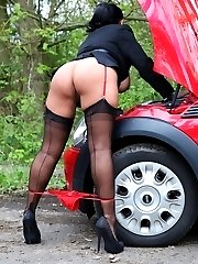 Danica awaits help when her car breaks down