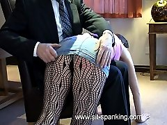 Spanked and strapped on her red raw bottom with tights and panties around her knees