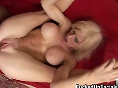 Busty blonde spreads her legs wide and fucks