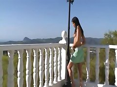 Extremely hot model peeing on a terrace