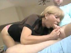 Milf sucks big dick on her knees