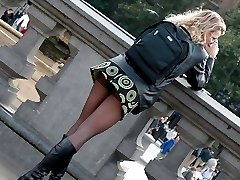 Voyeur upskirt pictures with panty peeking out in public