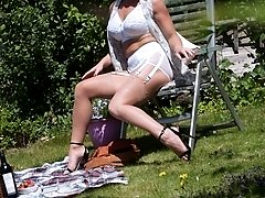 A peeping tom is spying on Ashleigh sunning herself in the garden!