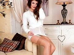 Bashful Briony strips down and masturbates in nylons, heels and garters for the first time!