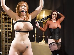 Mistress Bella Rossi has redhead bombshell Lauren Phillips bound and at her mercy. Lauren begs...