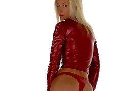 Blonde in red latex fit