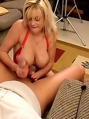Busty blonde gives an amazing tugjob
