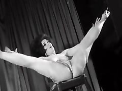 Vintage Stripper Dancing on a Stage 1960s Retro