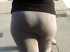 Latina booty in grey leggings