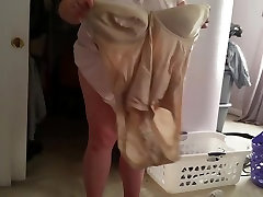 squeezing her bbw body & big tittys into her girdle