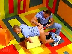 Two men double penetrate blond twink