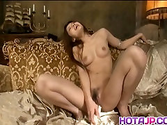 Mei Haruka sexy Asian milf exposes pussy and masturbates in