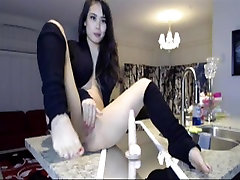Asian girlfriend riding a huge dildo on the kitchen counter