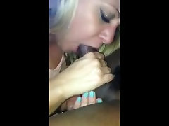 Blonde milf sucking black cock and swallowing load