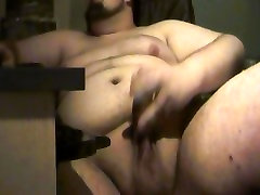 Young and naked chubby boy jerks his big dick and cums