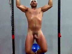 Showing off all his assets at the exercise bar