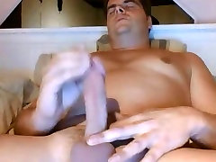 Very handsome bear stroking his fat cock