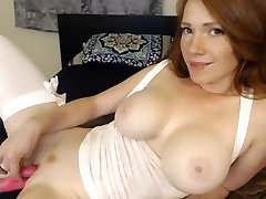 Gorgeous red head with lovely big breasts