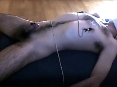 Male tied, edged with vibrator and nipple clamps