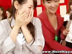 One oriental chick jerks off dude on stage
